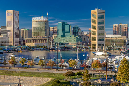 OCTOBER 28, 2016 - Baltimore Inner Harbor late afternoon lighting of ships and skyline, Baltimore, Maryland, shot from Federal Park Hill