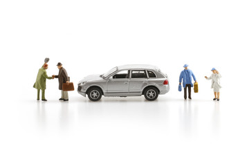 Miniature business people with car