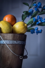 citrus fruit in a wooden bucket decorative background