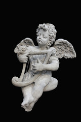 Cupids statue isolated on black background