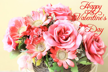 Artificial Flowers with pink roses and Zinnia in basket for decoration wedding party or Valentine's Day as background or print card. With Text : Happy Valentine's Day