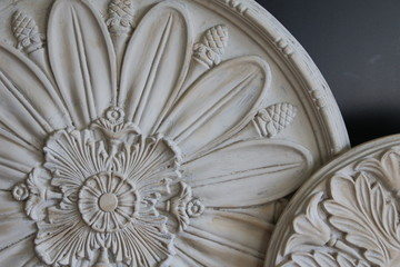 Close Up of Round / Circular Decorative Ceiling Medallions Architectural Elements, Against Black Background