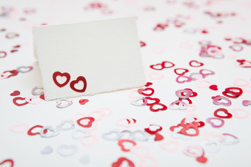 Valentines day greeting card on a white background with hearts confetti