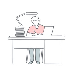 man writing sitting in front of laptop at the table