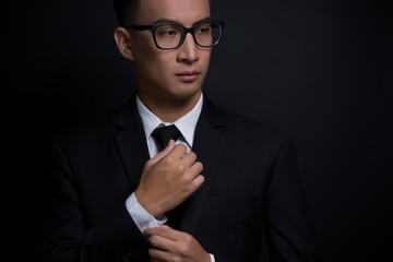 Businessman adjusting his cufflinks