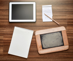 My notepads, spiral binder,chalkboard,note paper and tablet. Soft light effect added.