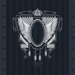 Oval frame with ribbons between open wings. Heraldic vintage label on blackboard