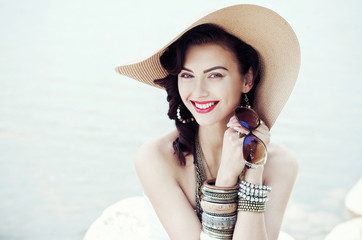 Portrait of beautiful stylish and fashionable girl in a hat
