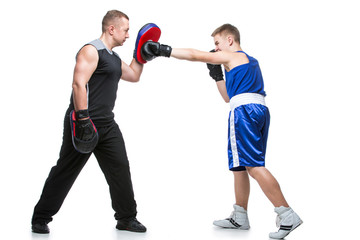 Young boxer working out with coach