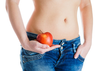 Female belly. Woman Hands holding red apple. IVF, pregnancy, diet concept.