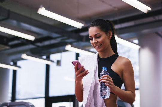 Portrait of personal trainer woman at gym after fitness workout