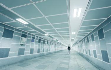 Man walking through a surreal tunnel
