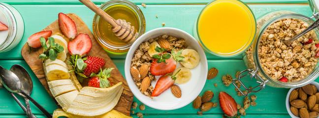 Breakfast - strawberry and banana muesli with yogurt