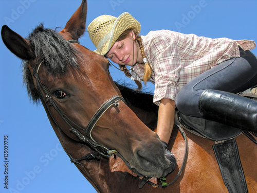 quotyoung cowgirl horseback ridingquot stock photo and royalty