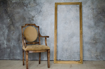 chair and frame on a background of gray wall