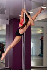 Woman in a pole dance studio