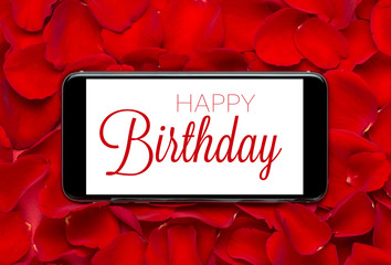 Happy Birthday text on Smartphone screen with Roses background.