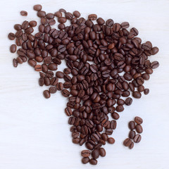 Afrikaans origin present/ coffee beans collected on the table in the shape maps continent, a top view