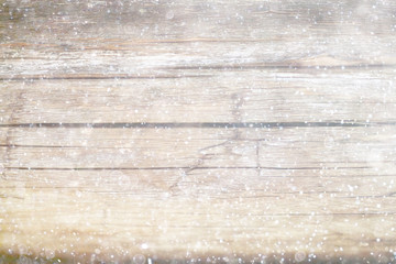 blurred wooden background with snow winter