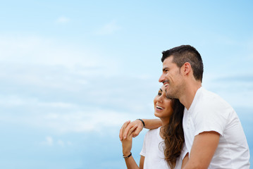 Couple love and life together concept. Young loving man and woman against blue copy space background.