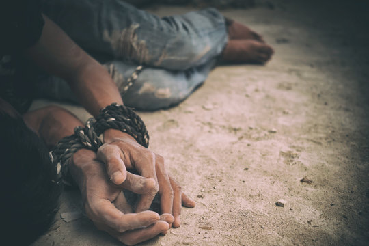 hopeless man hands tied together with rope