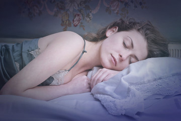 Girl sleeping tight in bed