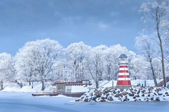 Navigation lighthouse on the winter coast