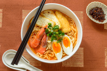 Laksa is a popular  food in the Peranakan cuisine, which is a combination of Chinese and Malay cuisine. It consists of rice noodles with chicken, prawn or fish, served in spicy soup