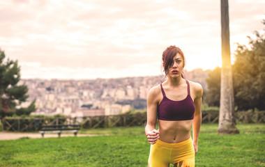Stunning sportswoman running in a park