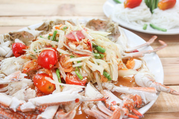 Spicy papaya salad with blue crab sea food.