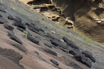 Fire mountains and barren volcanic lava landscape in Timanfaya national park