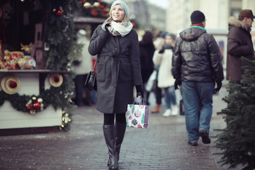 urban portrait of woman in winter clothes