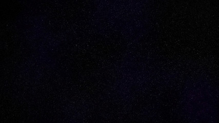 dark blue evening sky with many distant stars twinkling in deep space