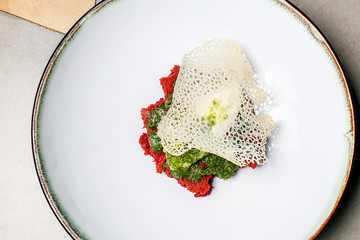 An unusual dessert for Valentine's day with cream, mint and baking