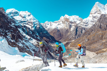 Group of Mountain Hikers traversing Glacier