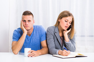 Husband is very sad and he is feeling bored because his wife is thinking of her business all of the time.
