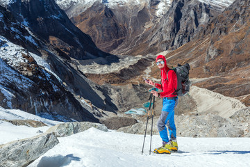 Mountain Climber using Cell Phone at high Altitude extreme Conditions