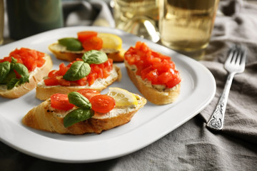 Delicious toast with tomatoes on plate