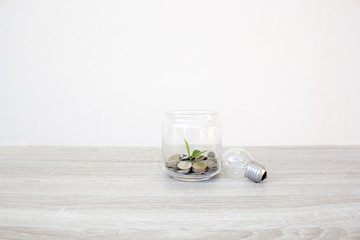 Coins in glass on wooden table, Concept Business and financial