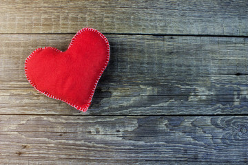 Fluffy red heart hand made on an old wooden table