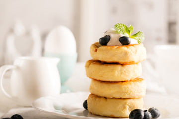 Sweet cheese pancakes on a plate with berries