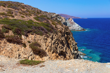 Top view of the  rocks in a small town called Agia Pelagia, Crete. Beautiful mountainous sea shore. Sea landscape on a hot summer day. Inaccessible cliffs on the coast.