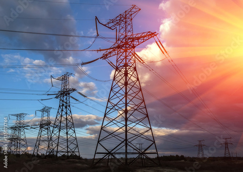 """ high-voltage power lines at sunset. electricity ..."
