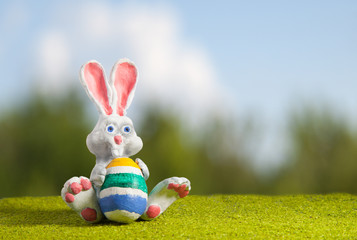 White Rabbit from polymer clay on the lawn with painted egg char