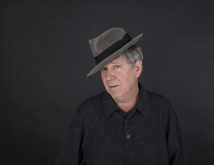 portrait of cool looking handsome man with hat