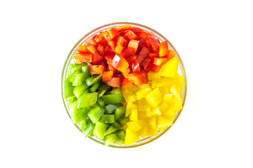Diced Red, Green & Yellow Pepper together in white bowl