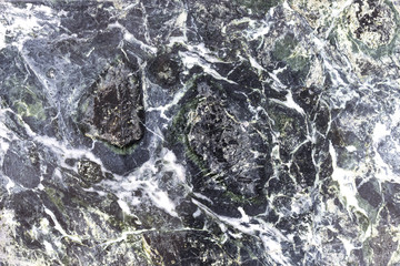 Contrasty stone background with cracks, black marble