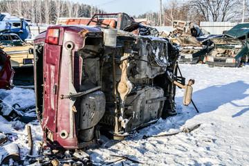 broken car in a landfill