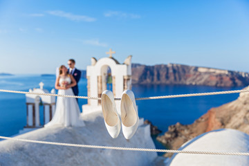 Wedding shoes and young couple