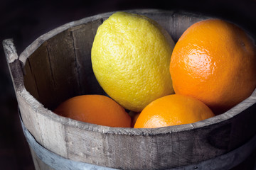 citrus fruit in a wooden bucket